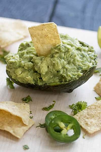 Homemade guacamole served in an avocado shell