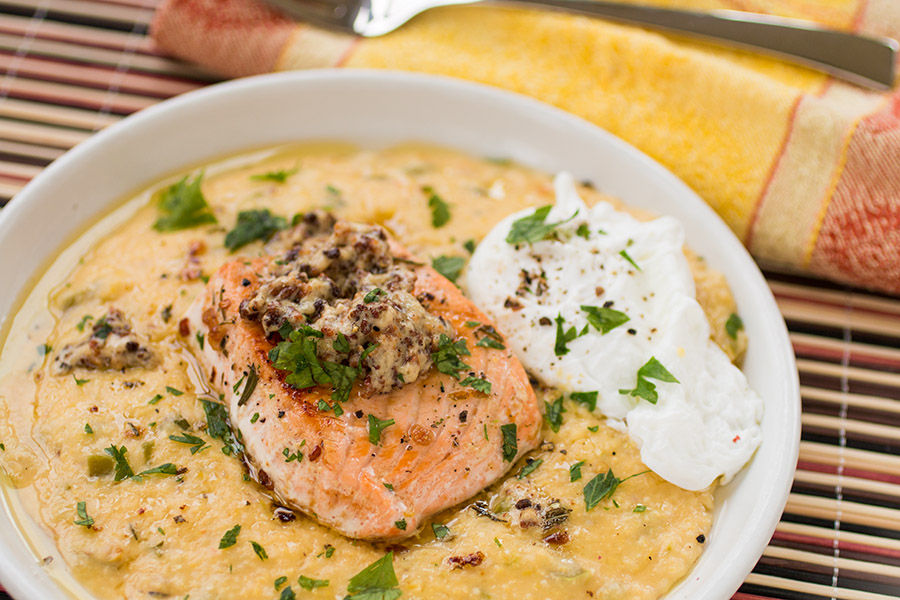 Butter Poached Salmon Over Cheesy Grits with Poached Egg and Bacon Gravy