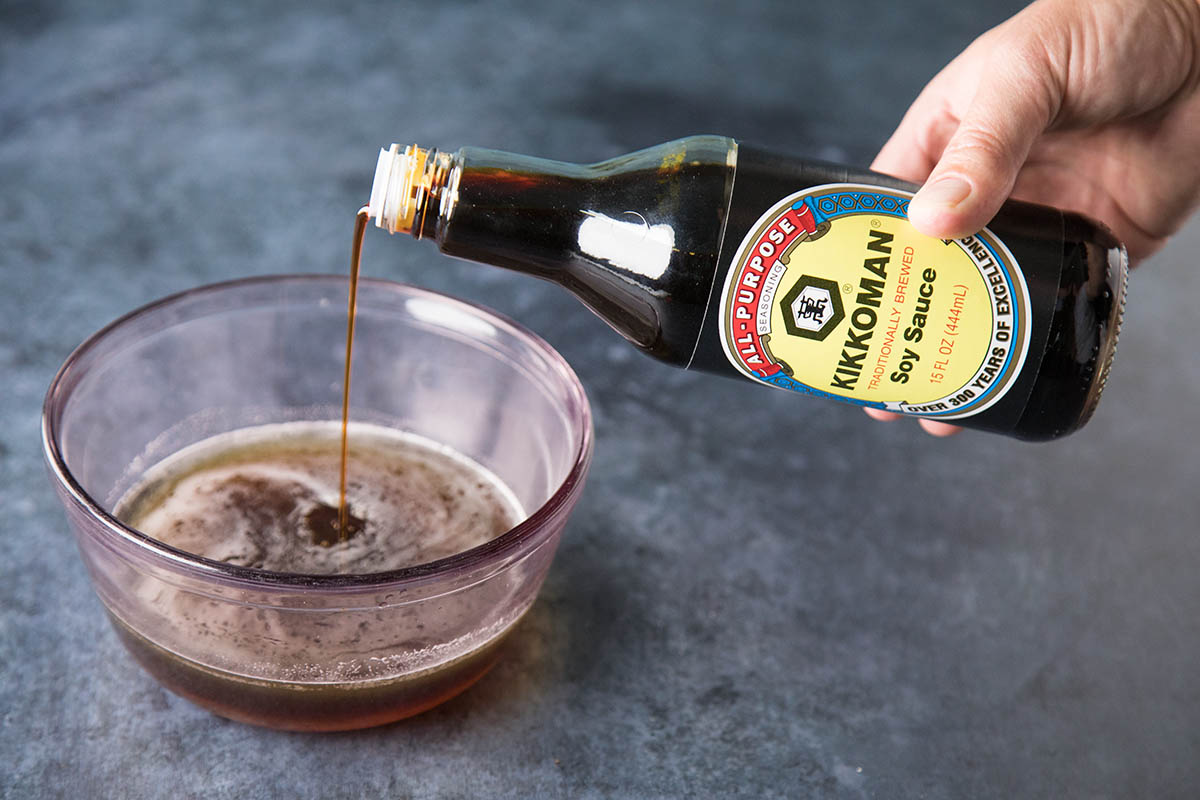 Pouring Soy Sauce for Honey-Soy Glazed Cornish Hens with Sausage-Panko Stuffing - Recipe