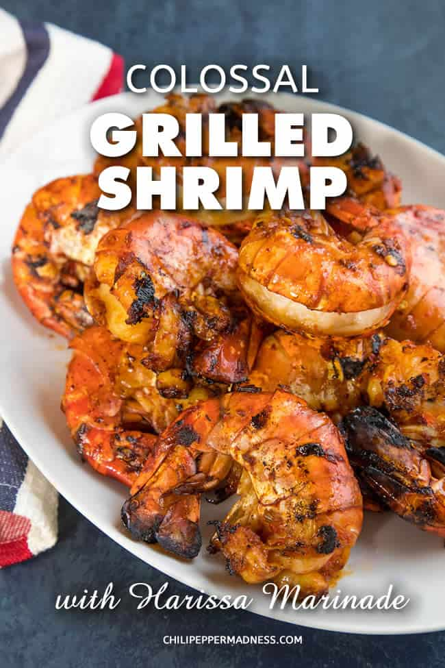 Colossal Grilled Shrimp with Harissa Marinade - Get your grills ready for this recipe of very large succulent shrimp that have been marinated in flavorful harissa, then grilled to perfection. They're super tender and huge on flavor. #Shrimp #GrilledShrimp #Grilling #SummerFood #Seafood #Dinner #Harissa #Shellfish #SpicyFood #Spicy