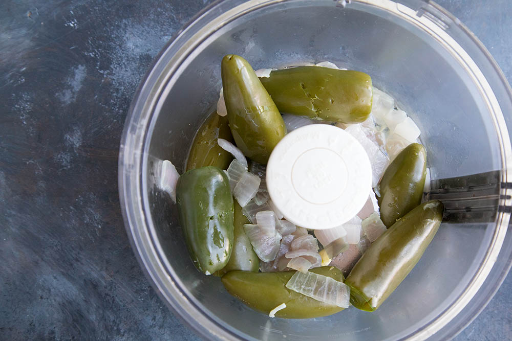 Processing the boiled jalapenos and onions for our creamy jalapeno sauce