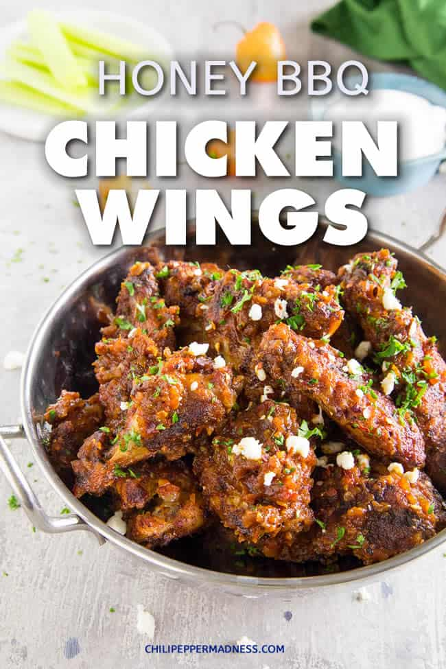 Crispy Baked Honey BBQ Chicken Wings - These honey-bbq chicken wings are seasoned then baked until nice and crispy, then slathered in honey-barbecue sauce that is sweet, spicy and has just the right amount of tanginess. Here is the recipe. Perfect for parties or any night of the week. | ChiliPepperMadness.com #chickenwings #wings #partyfood #bbqwings