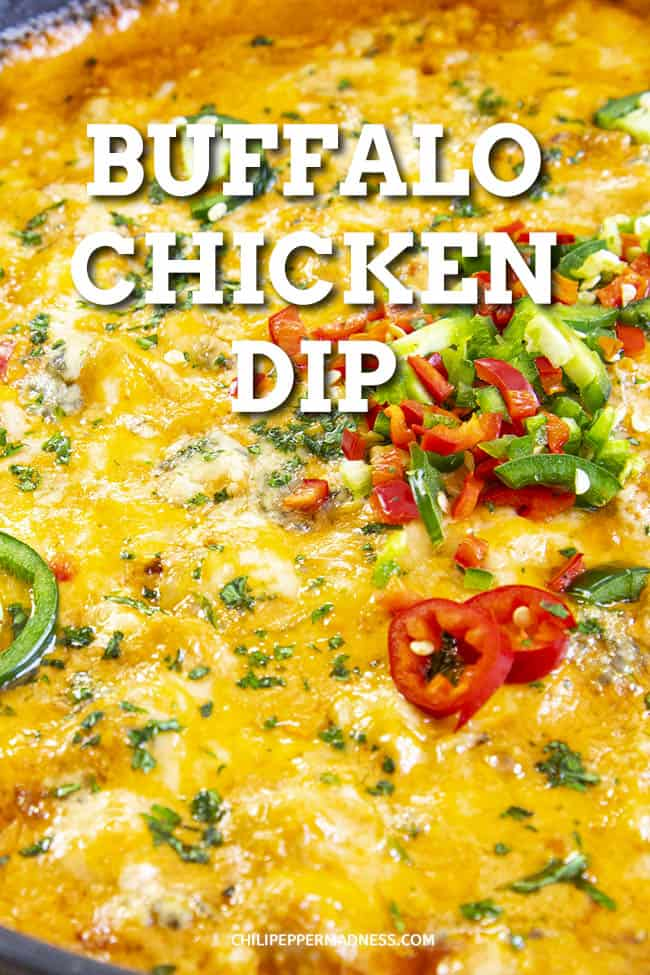 Spicy Buffalo Chicken Dip Recipe - A classic Buffalo chicken dip recipe made with three cheeses, tender simmered chicken, Buffalo sauce, plenty of spices and three types of spicy chili peppers. This is the best buffalo chicken dip I have EVER tasted. #Spicy #ChickenDip #BuffaloDip #Appetizer #PartyFood #GameDayFood #Tailgaiting #Cheese #Habaneros #Jalapenos