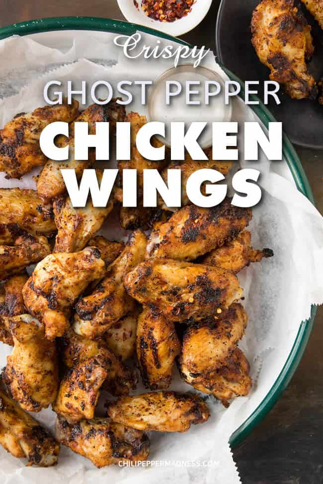 Crispy Grilled Ghost Pepper Chicken Wings - A recipe for spicy grilled ghost pepper chicken wings that have been rubbed down with a vibrant mix of ghost pepper flakes and other seasonings, then grilled to crispy perfection. Fire up those grills and get cooking. For true spicy food lovers. #Dinner #Wings #ChickenWings #Grilling #GhostPeppers #Spicy #ExtraSpicy