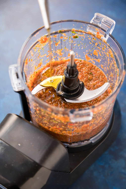 Peri Peri Sauce in a blender, adding olive oil