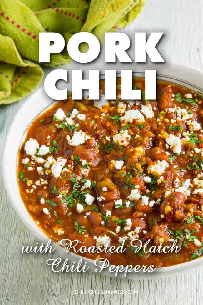 Pork Chili with Roasted Red Hatch Peppers - This pork chili recipe is made with chunks of tender pork shoulder, roasted red New Mexican peppers, fire roasted tomatoes and a mix of chili powders that are huge on flavor. Grab a bowl! Perfect for game day. #dinner #Chili #OnePot #Spicy #HatchPeppers #PorkChili #PorkShoulder