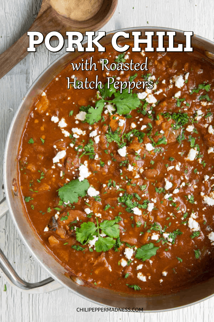 Pork Chili with Roasted Red Hatch Peppers - This pork chili recipe is made with tender pork shoulder, roasted red New Mexican peppers, fire roasted tomatoes and a mix of chili powders that are huge on flavor. Grab a bowl! Perfect for game day. #dinner #Chili #HatchPeppers