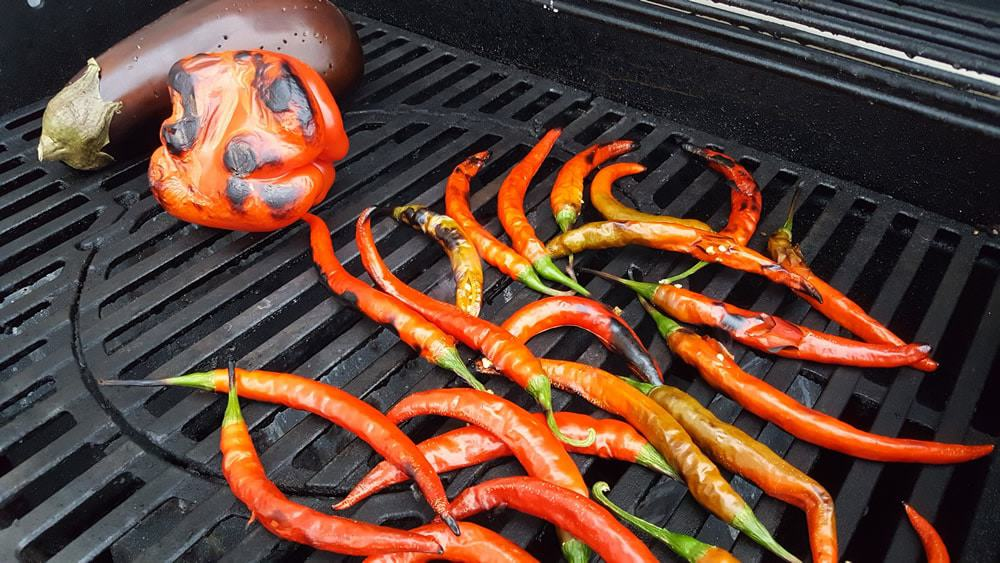 Roasting peppers and eggplant to make Ajvar