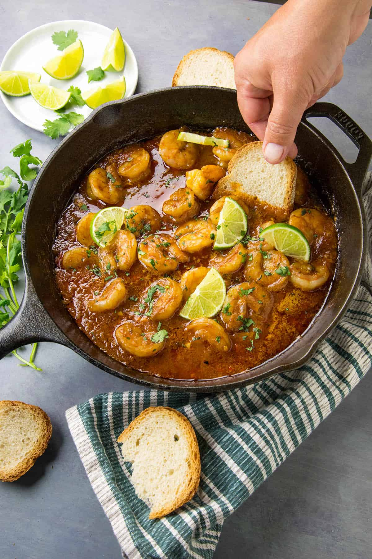 Dipping crusty bread into my Shrimp in Fiery Chipotle-Tequila Sauce to sop up the sauce