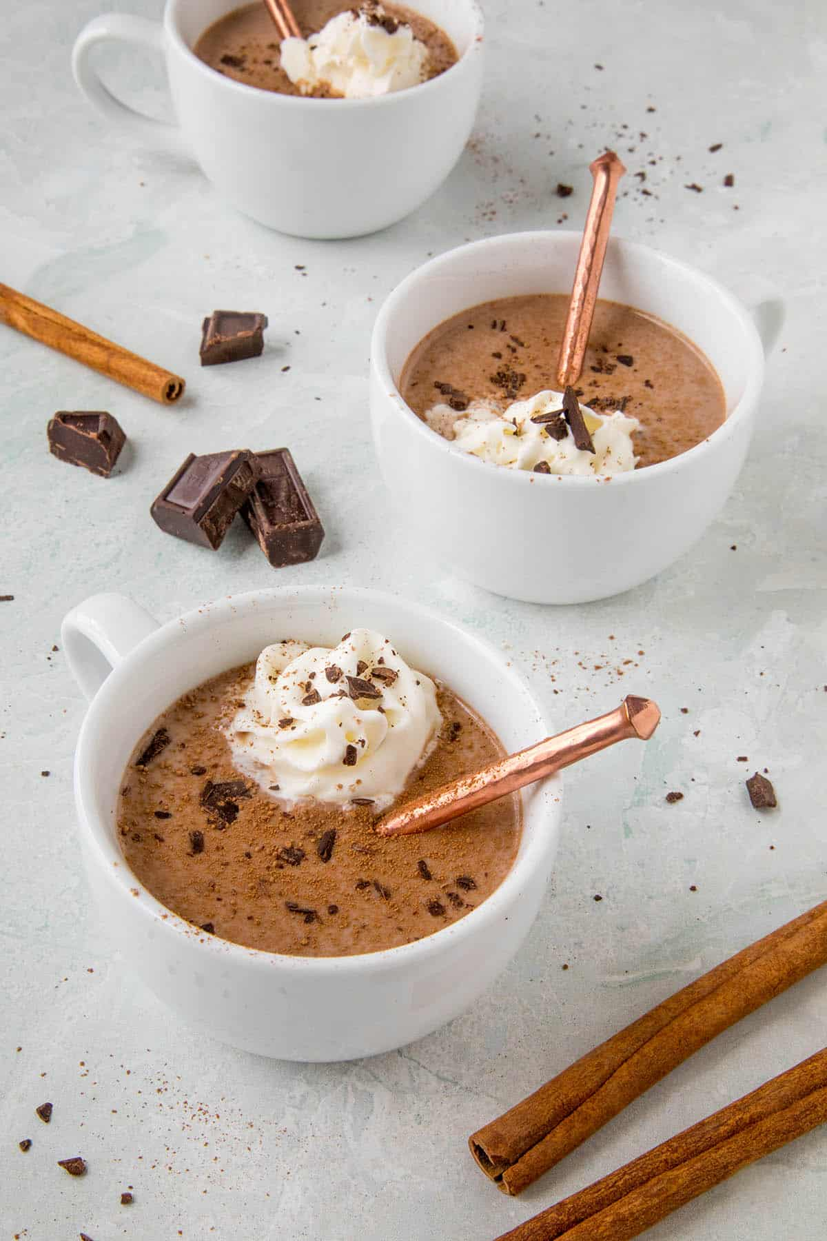 Mexican Hot Chocolate in a cup, ready to serve, with whipped cream