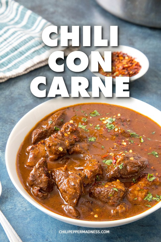 Chili Con Carne - A recipe for rich and authentic chili con carne, a spicy stew of beef and chilies, including ancho, guajillo and jalapeno, and many wonderful seasonings. Make it with or without beans. #chili #Dinner #Spicy