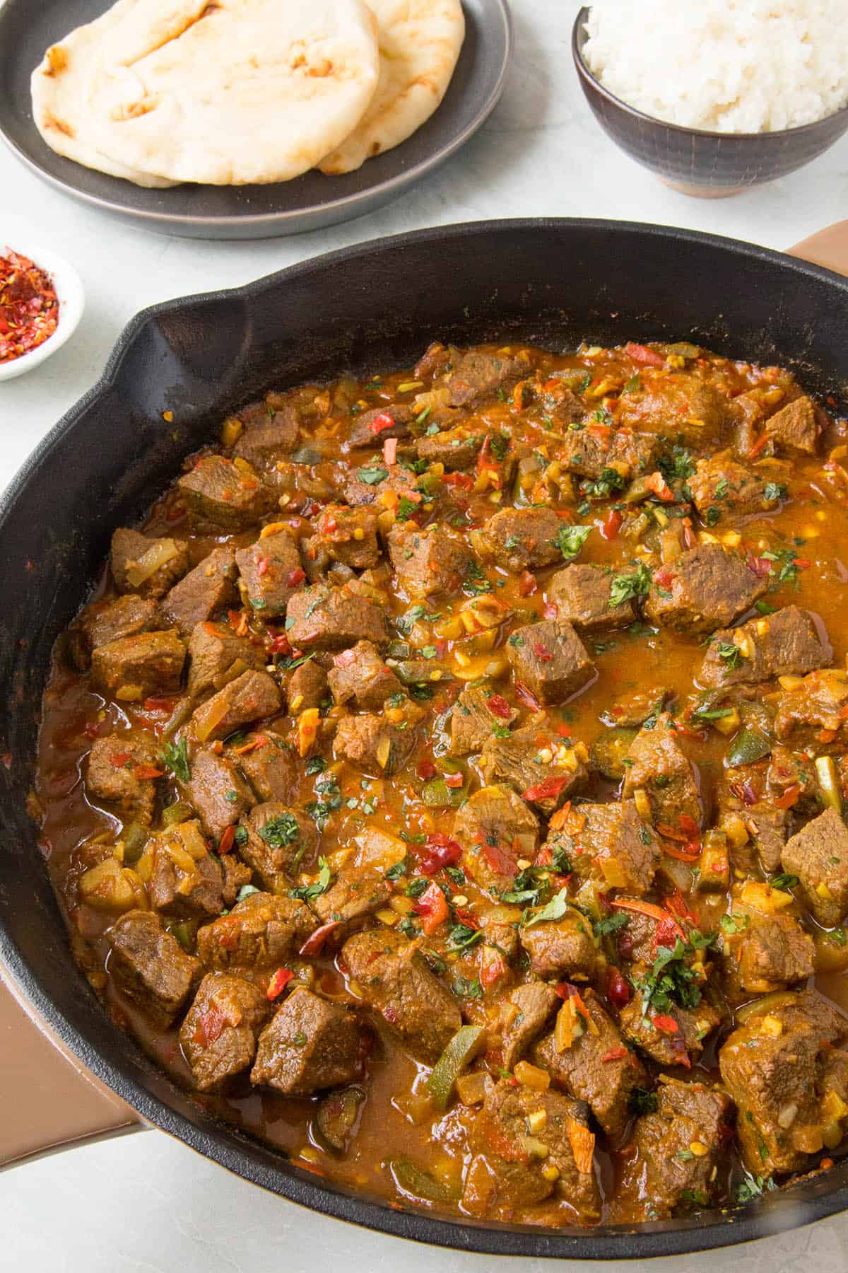 Beef Vindaloo, in a pan with extra spices