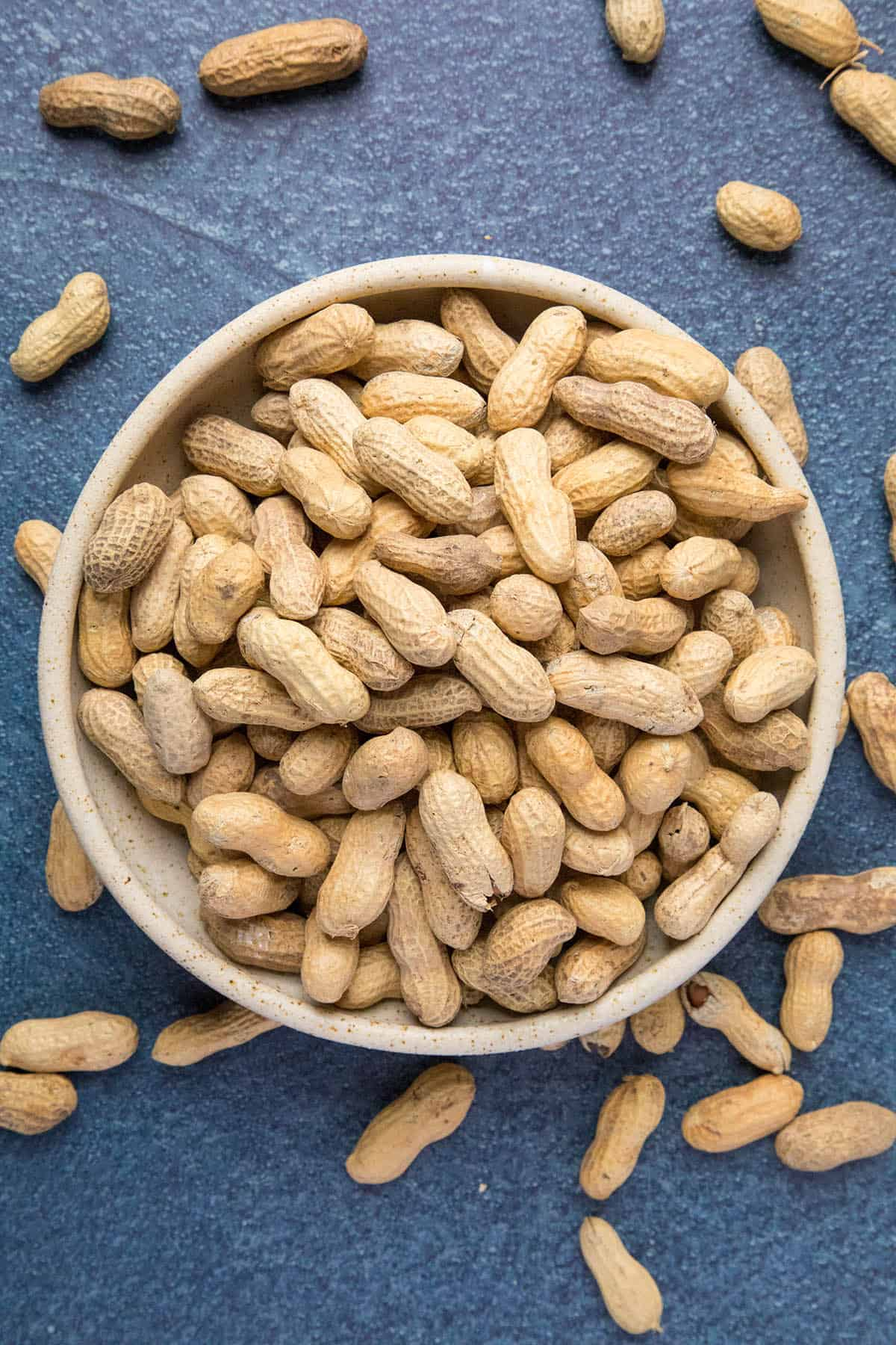 Raw green peanuts in a bowl