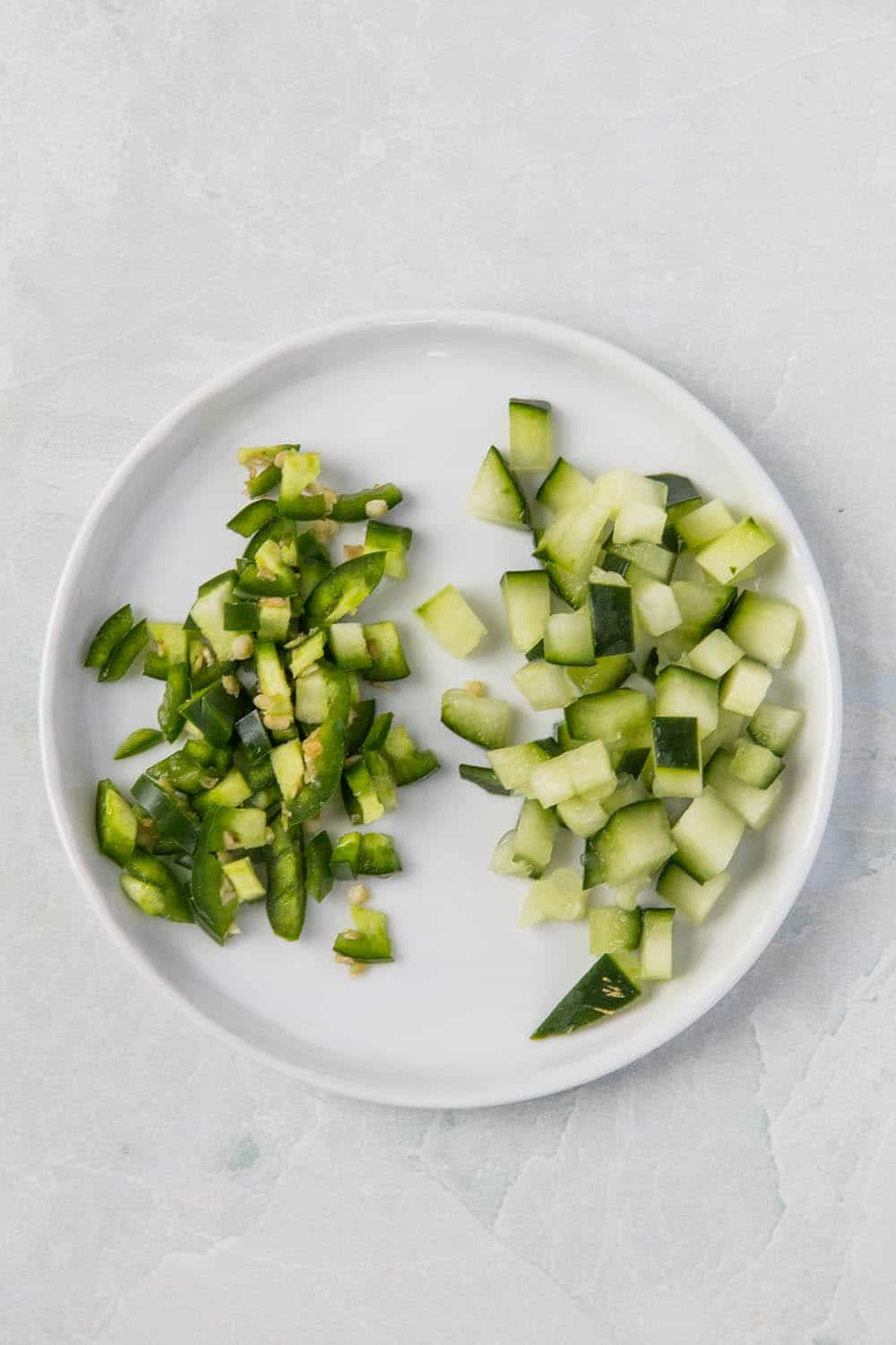 Diced cucumbers and serrano peppers