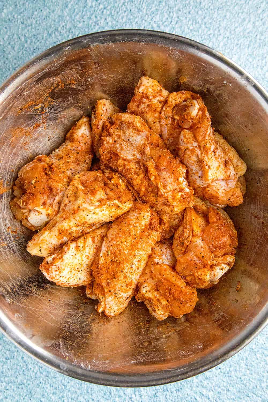 Seasoning the wings with my favorite Cajun seasoning blend