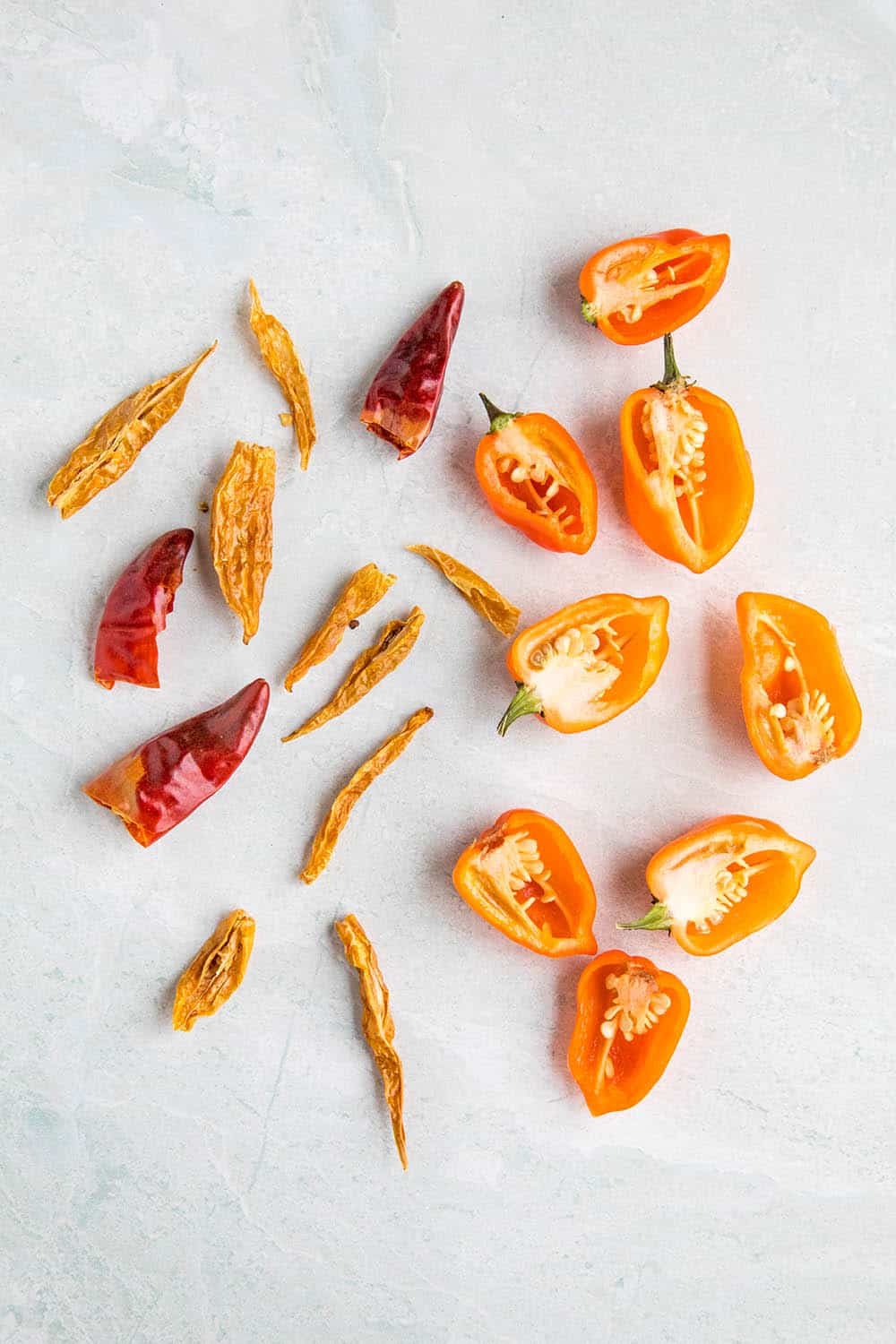 Fresh habanero peppers and dried spicy red peppers used to infuse honey with heat and flavor