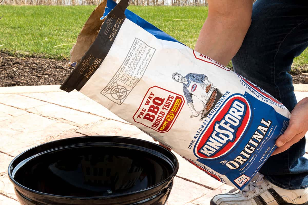 Pouring Kingsford Charcoal into my grill