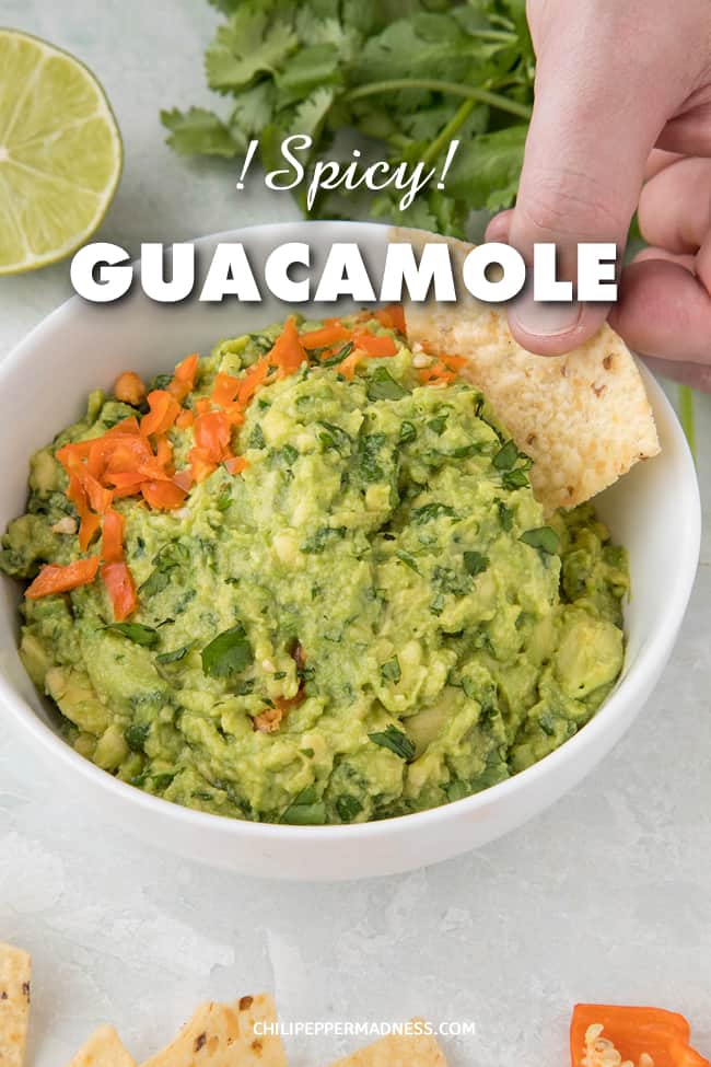 Homemade Spicy Guacamole Recipe - This creamy spicy guacamole recipe brings in the heat with diced habanero peppers for a guacamole like no other, the perfect party appetizer. #Guacamole #Appetizer #Habanero