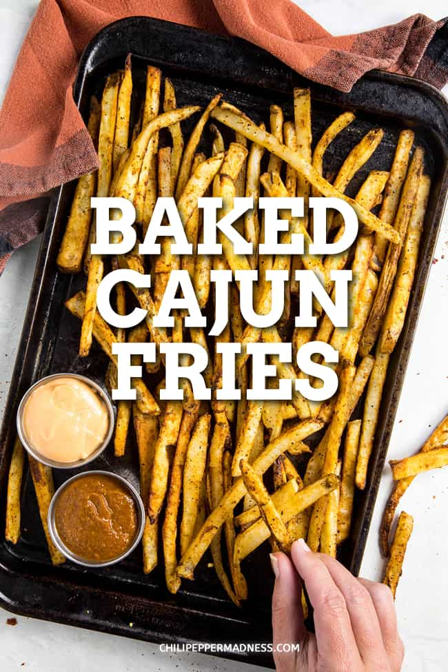 Baked Cajun Fries - This baked Cajun fries recipe makes the best crispy fries straight out of the oven. They have just the right amount of spice and make the best side dish. #Cajun #FrenchFries #SideDish