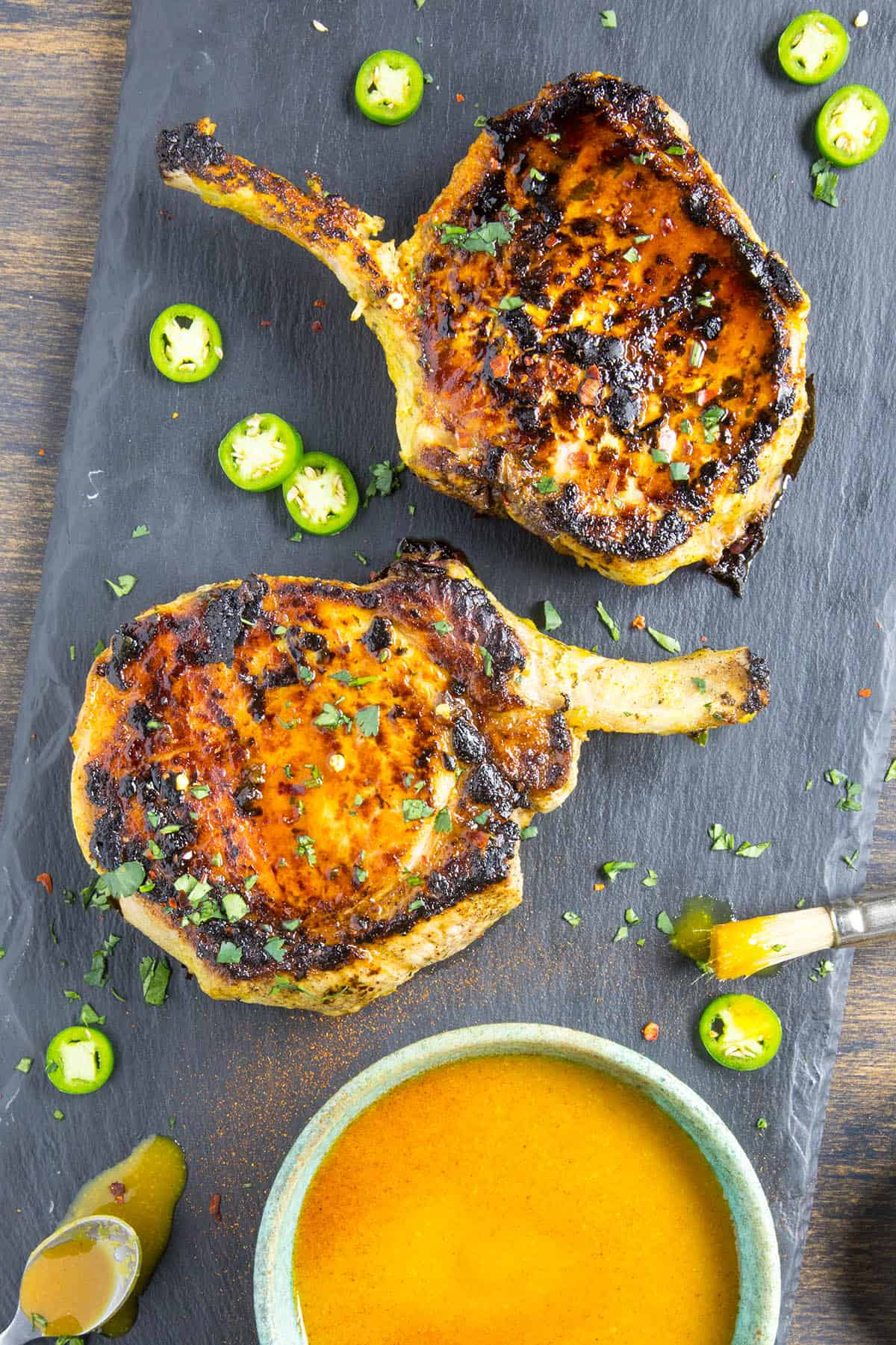 Grilled Pork Chops on a platter, ready for sauce