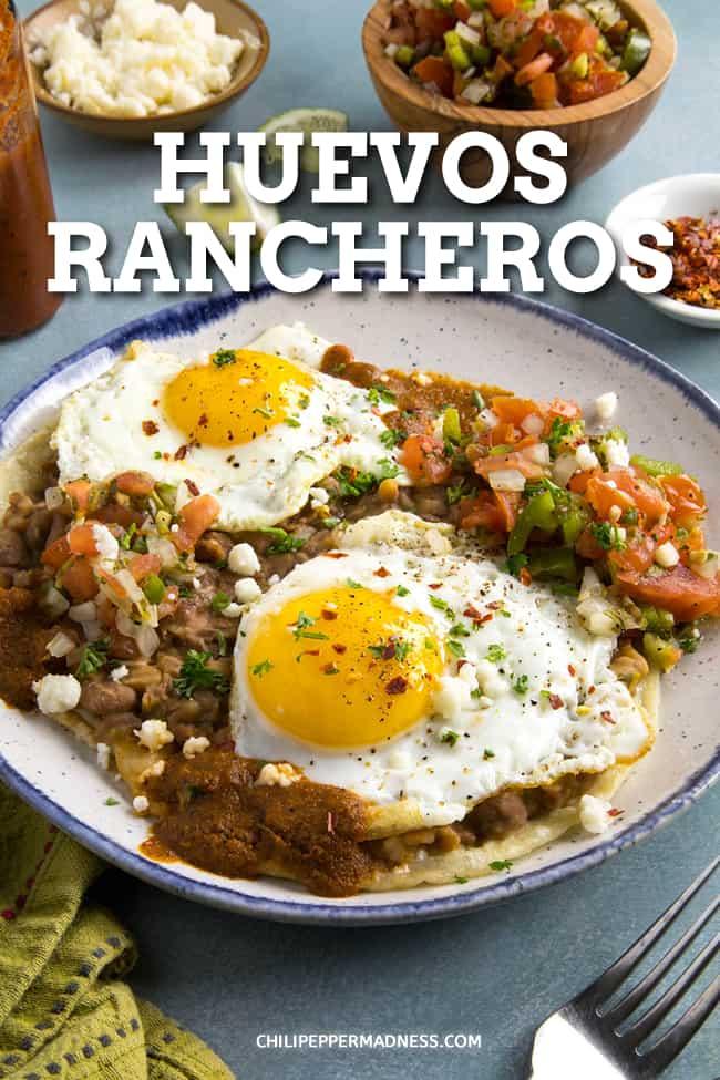 Easy Huevos Rancheros Recipe - This easy huevos rancheros recipe serves up ranch style eggs with fresh pico de gallo, refried beans and homemade ranchero sauce over corn tortillas. #Breakfast #MexicanFood