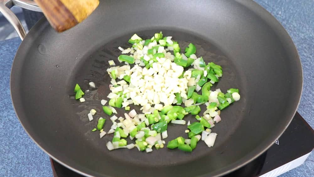 Cooking down the onions, jalapenos and garlic
