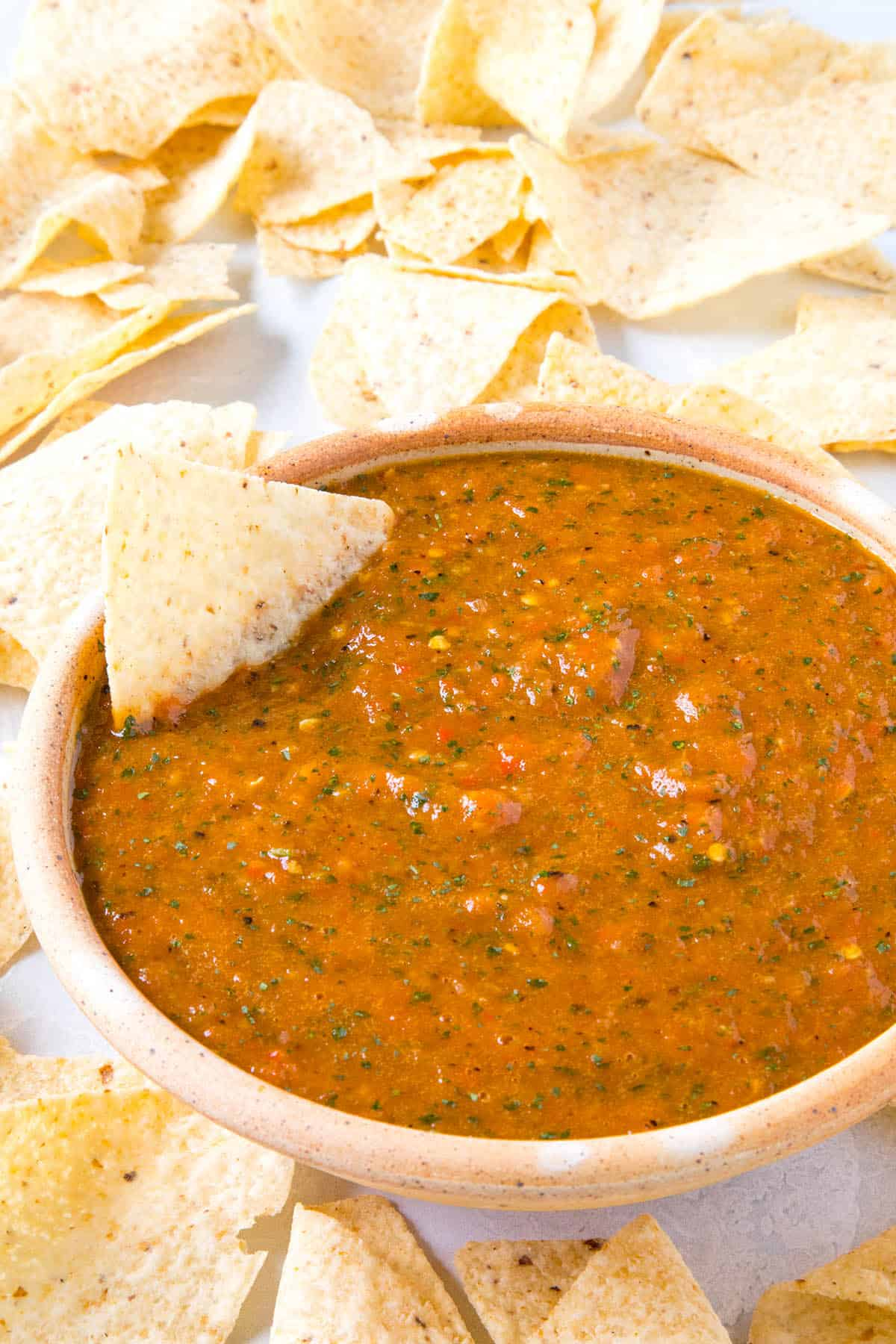 Roasted Mango-Habanero Salsa in a bowl with chips, ready to serve