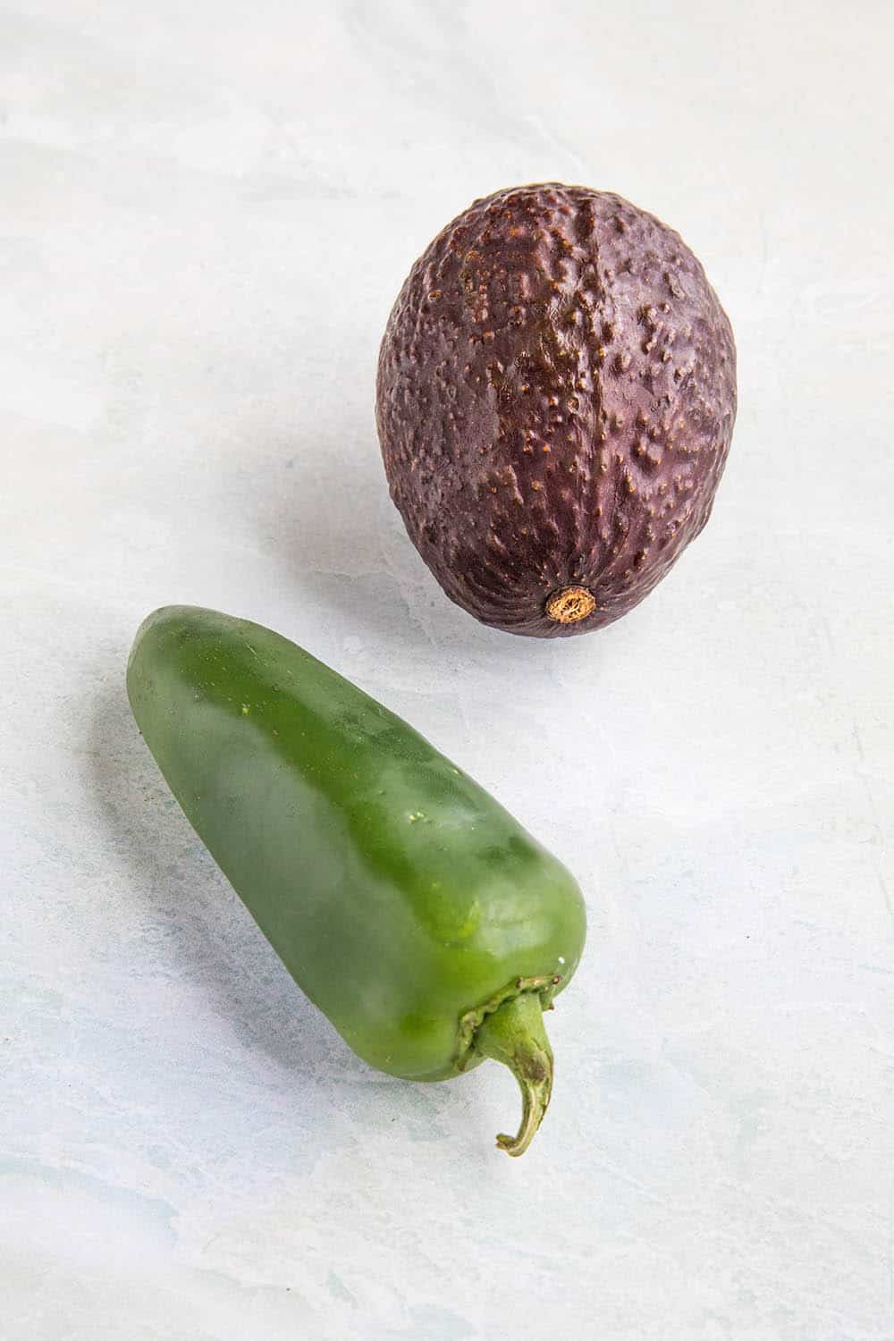An avocado and a jalapeno pepper, best friends
