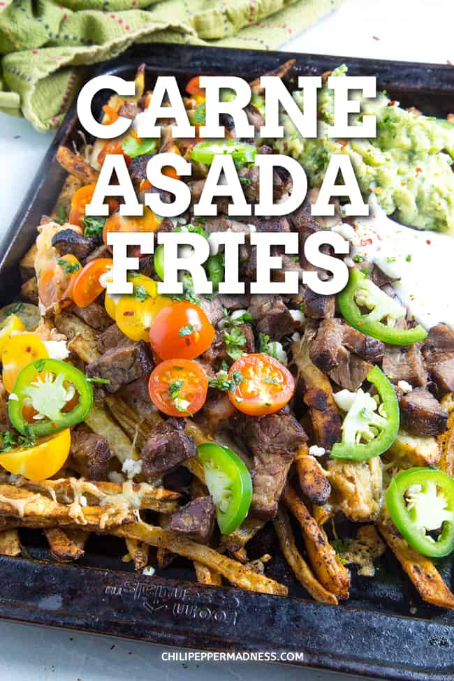 Loaded Carne Asada Fries Recipe - You need this carne asada fries recipe - tender marinated steak and crispy French fries, all smothered with melted cheese and loaded with your favorite toppings. #Appetizer #GameDayFood #PartyFood