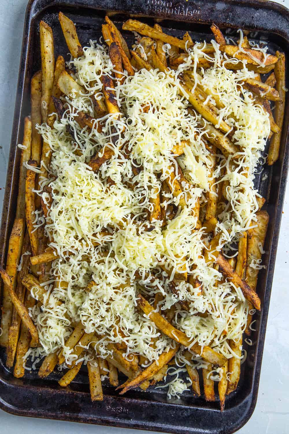 Topping the fries with cheese