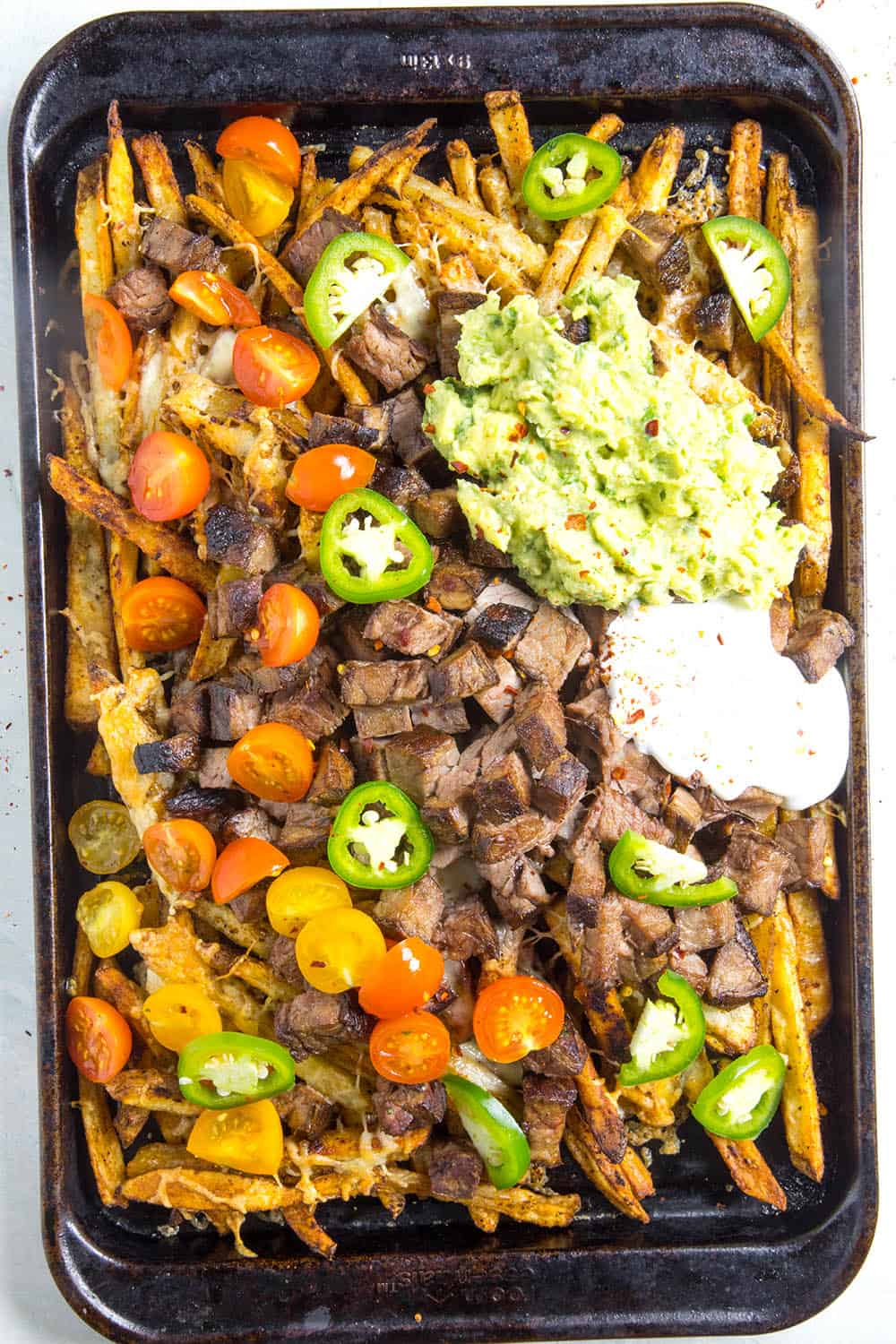 Carne Asada Fries on a baking sheet, ready to serve
