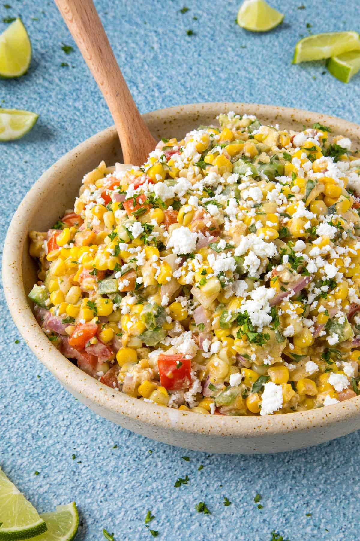 Elotes Salad in a bowl with crumbly white cheese over the top