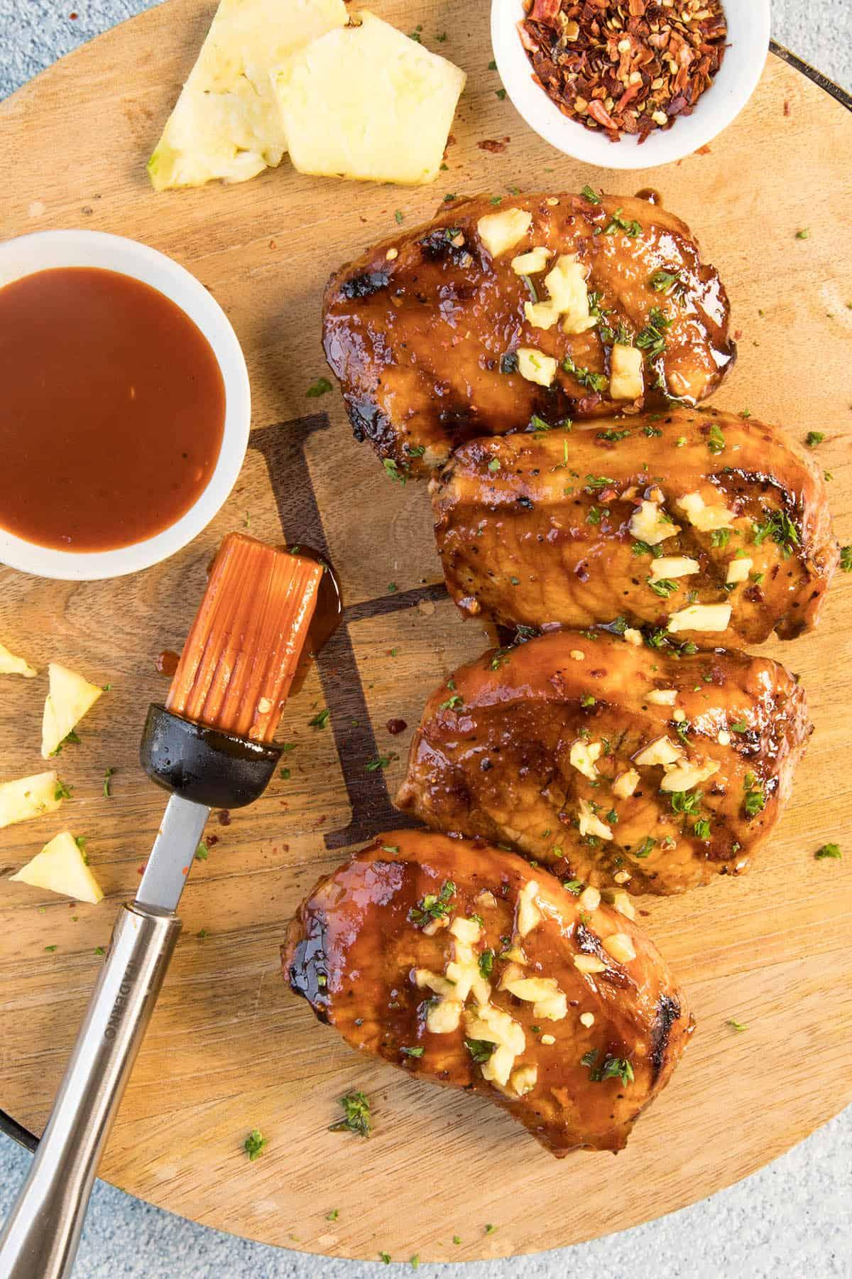 Grilled Pork Chops with Pineapple-Gochujang Glaze on a platter, ready to serve