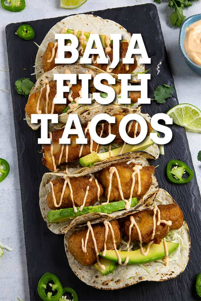 Baja Fish Tacos Recipe - This Baja fish tacos recipe serves up fresh mahi mahi coated with beer batter and fried golden, topped with crunchy slaw and homemade creamy fish taco sauce. Perfect tacos! #Tacos #Seafood