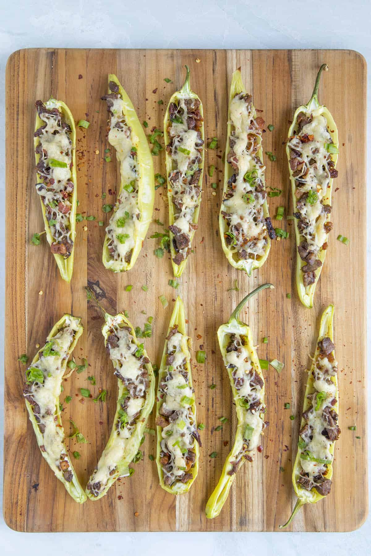 Stuffed Banana Peppers laid out on a serving board