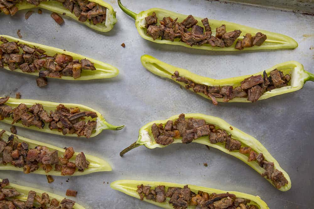 Stuffing the banana peppers with meat