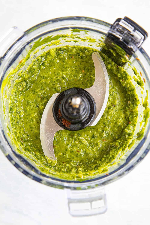 Green Harissa in a food processor, processed