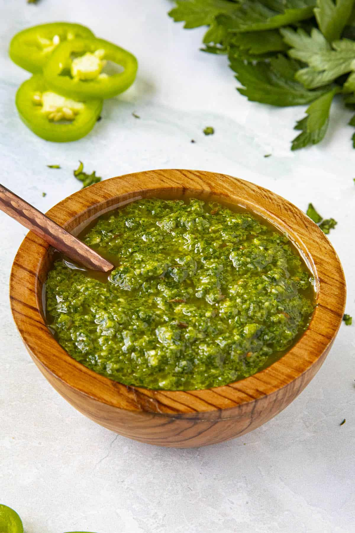 Green Harissa in a bowl with a serving spoon
