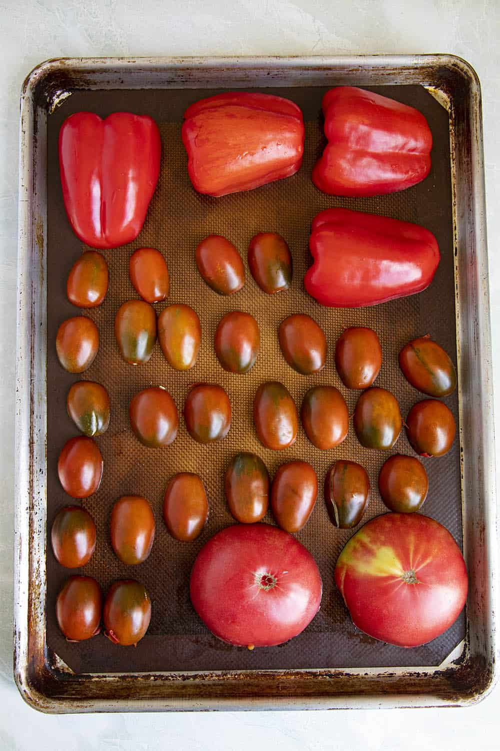 Tomatoes and peppers ready for roasting