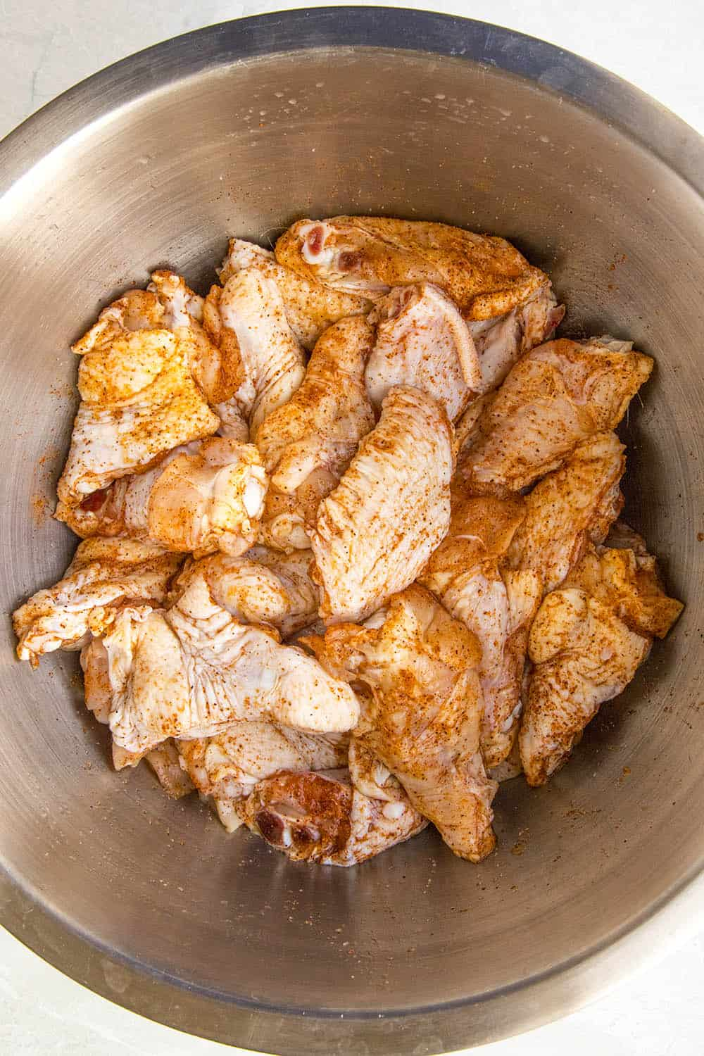Seasoned chicken wings, ready to cook