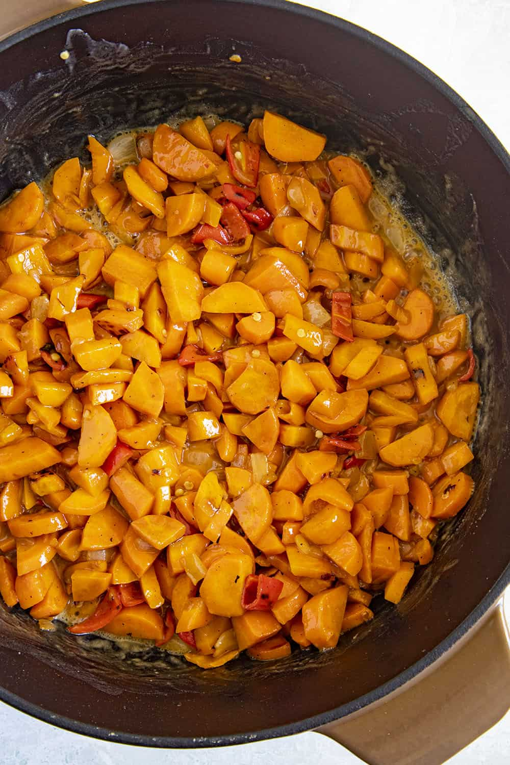 Add the carrots and peppers to the roux