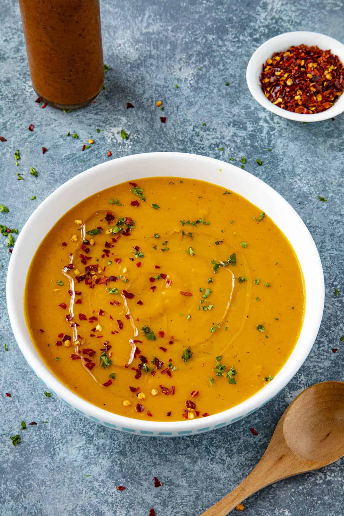 Spicy Cajun-Style Carrot Soup in a bowl with chili flakes