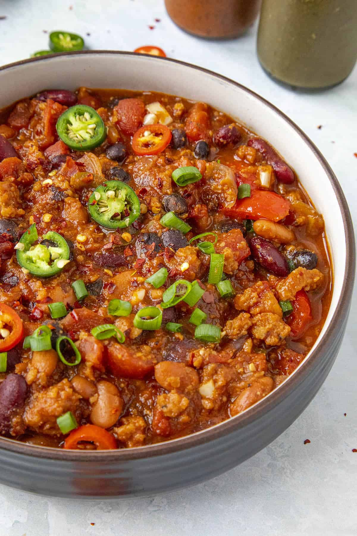 Chunky Vegetarian Chili in a bowl with garnish
