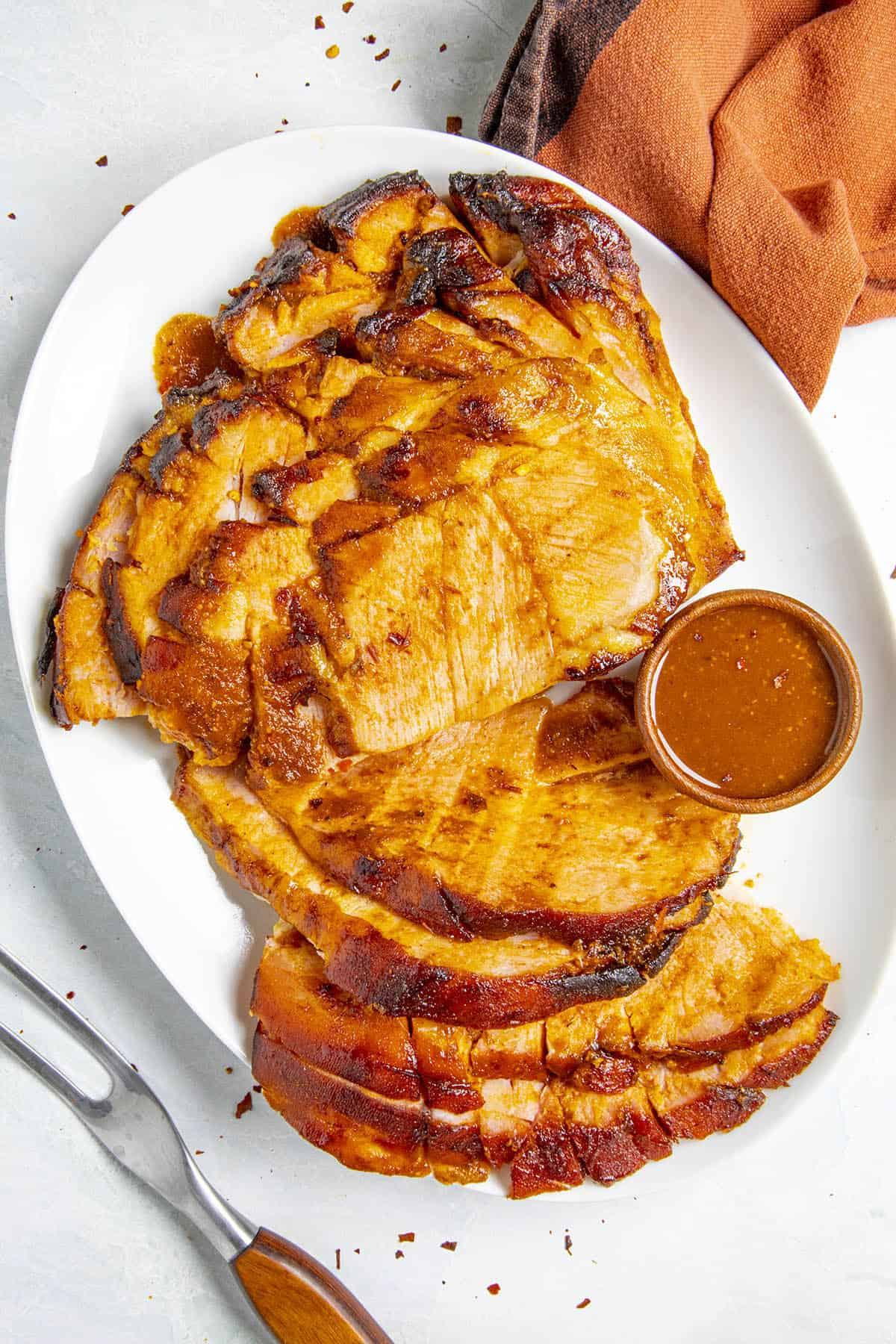 Baked Ham with Chipotle-Honey Glaze on a plate, ready to serve