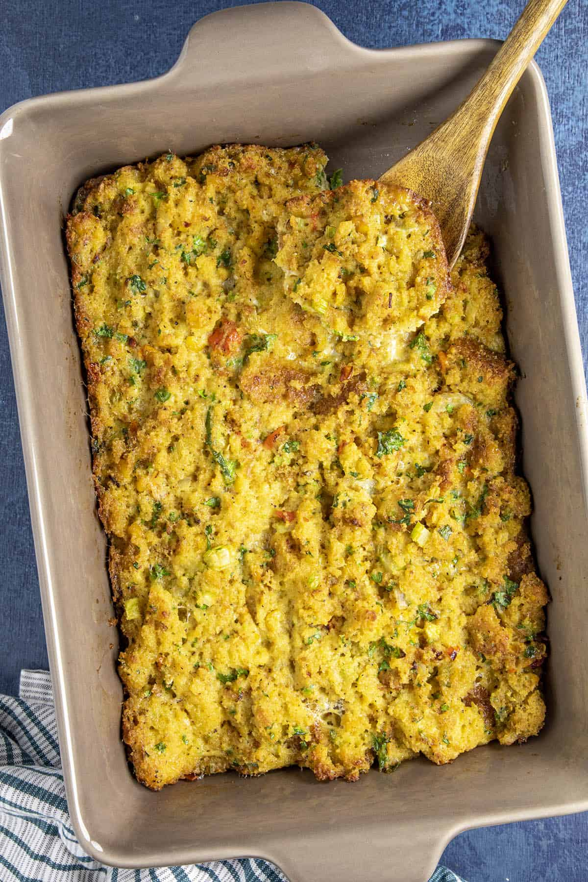 Cornbread Dressing being scooped from the casserole dish