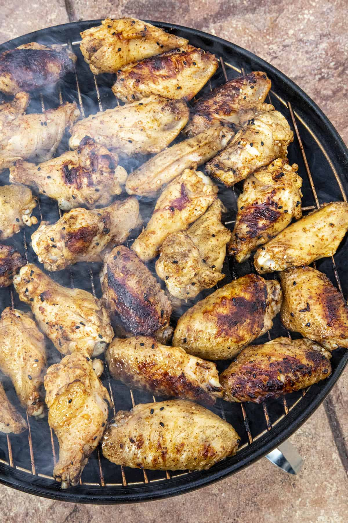 Grilled chicken on the grill, nicely charred