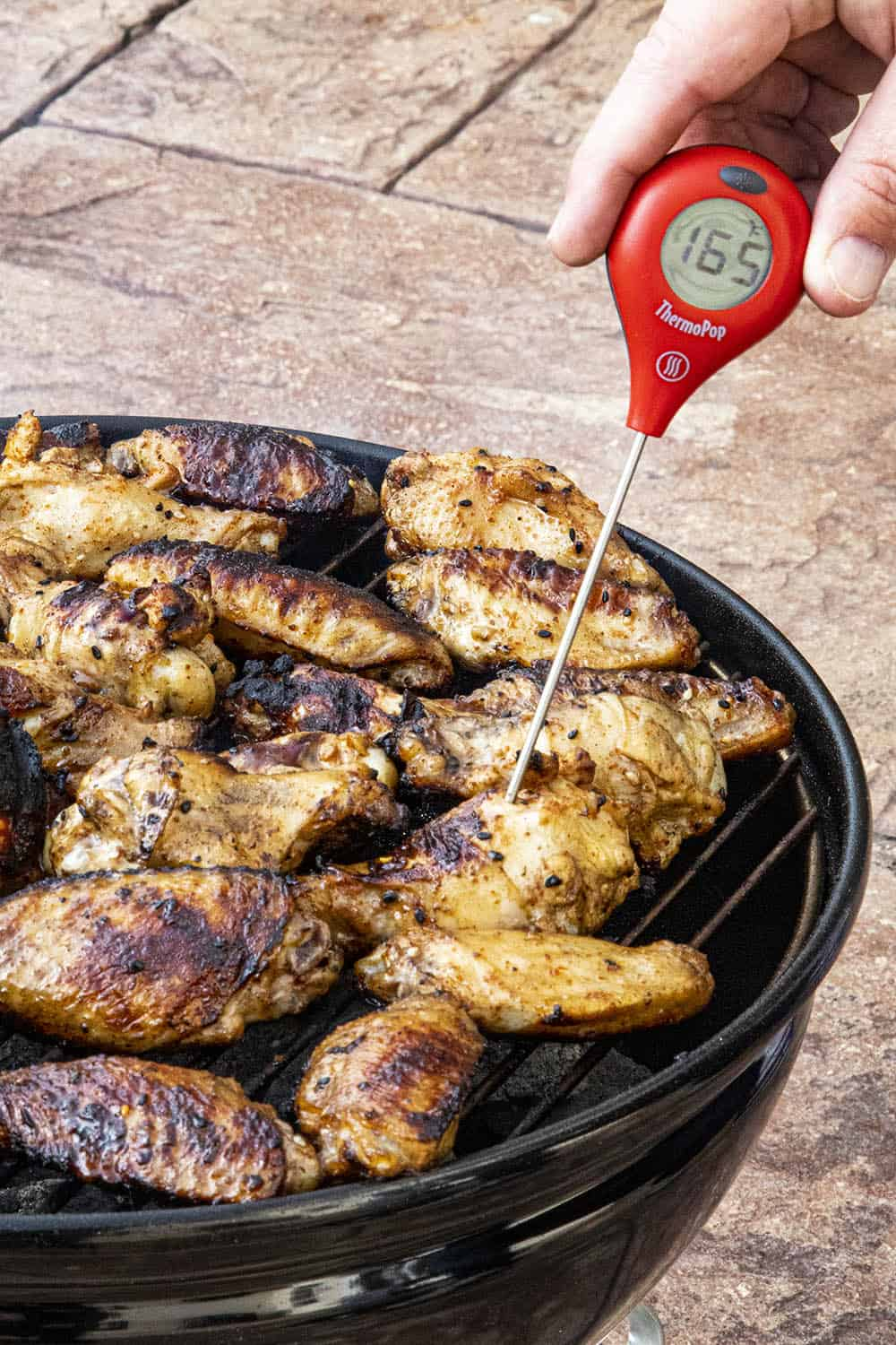 Checking the temperature of my grilled chicken wings