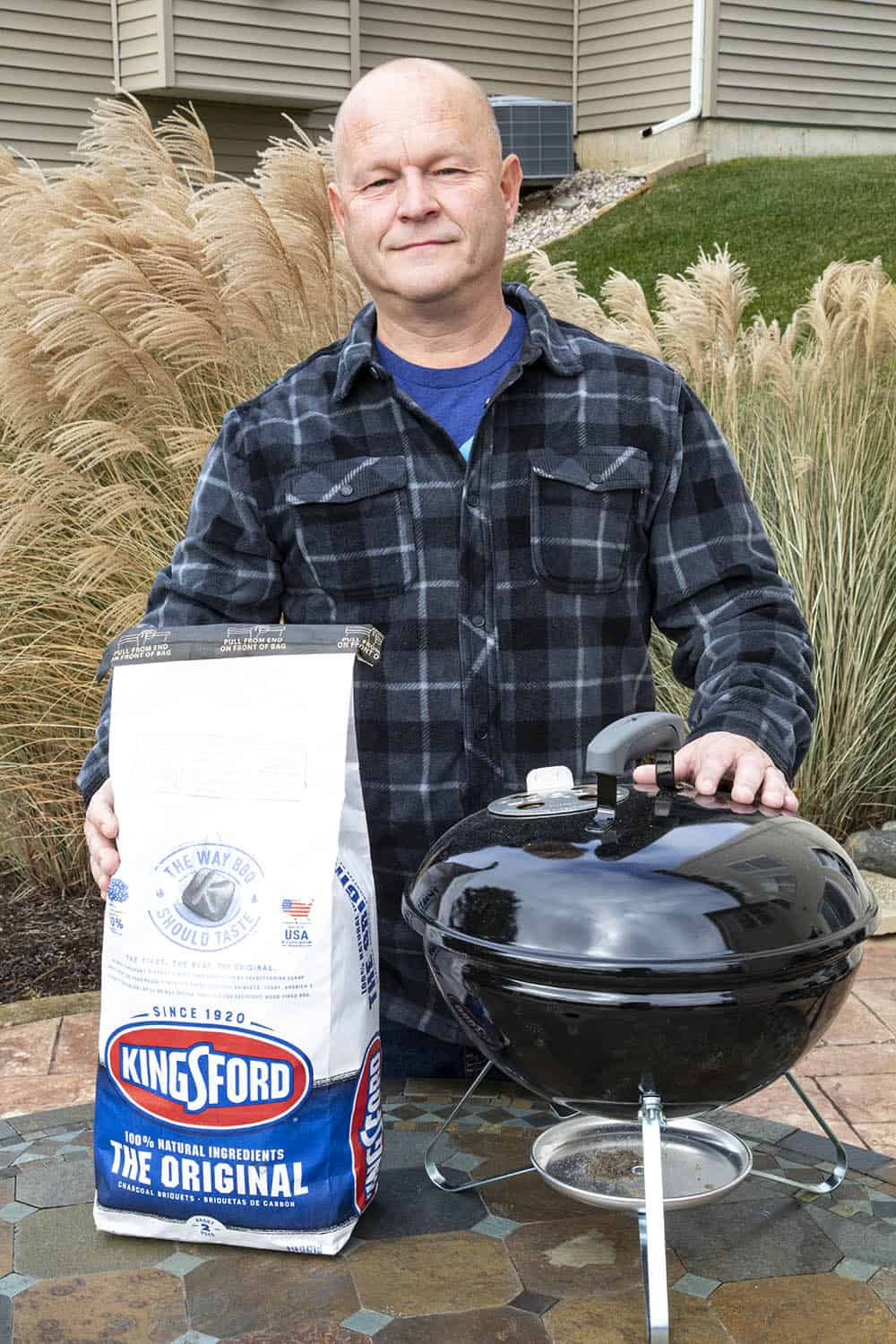 Mike standing in his backyard, ready to fire up the grill