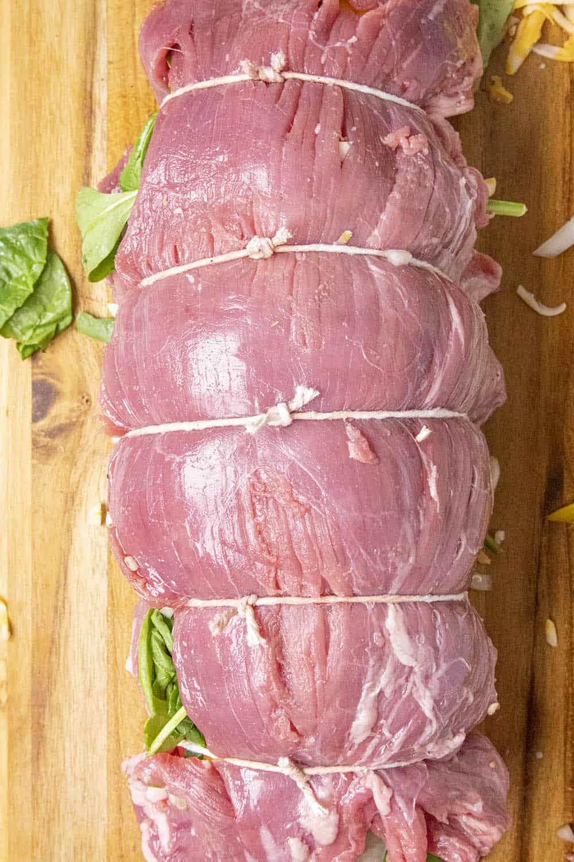 Stuffed flank steak tied off with kitchen twine
