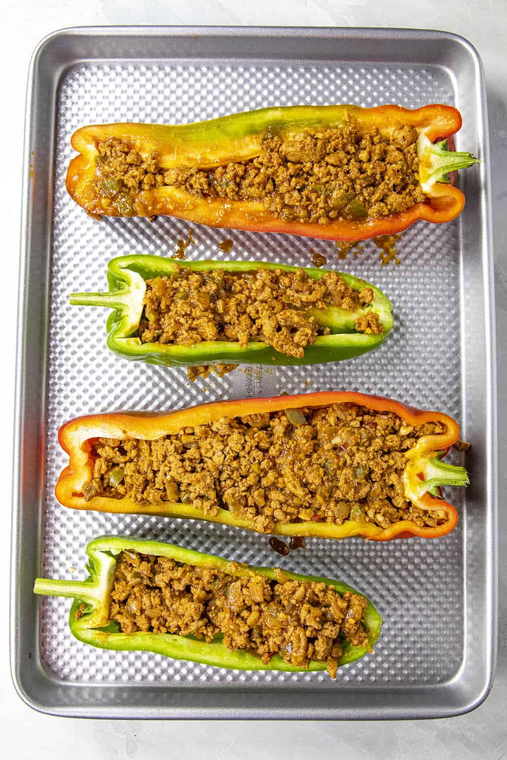 The sliced peppers stuffed with ground taco meat